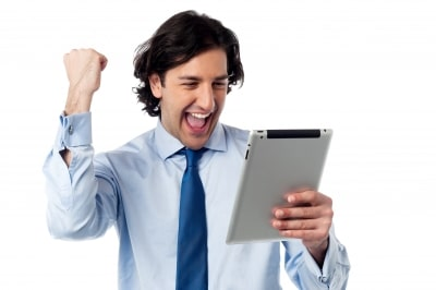 excited-businessman-holding-ipad